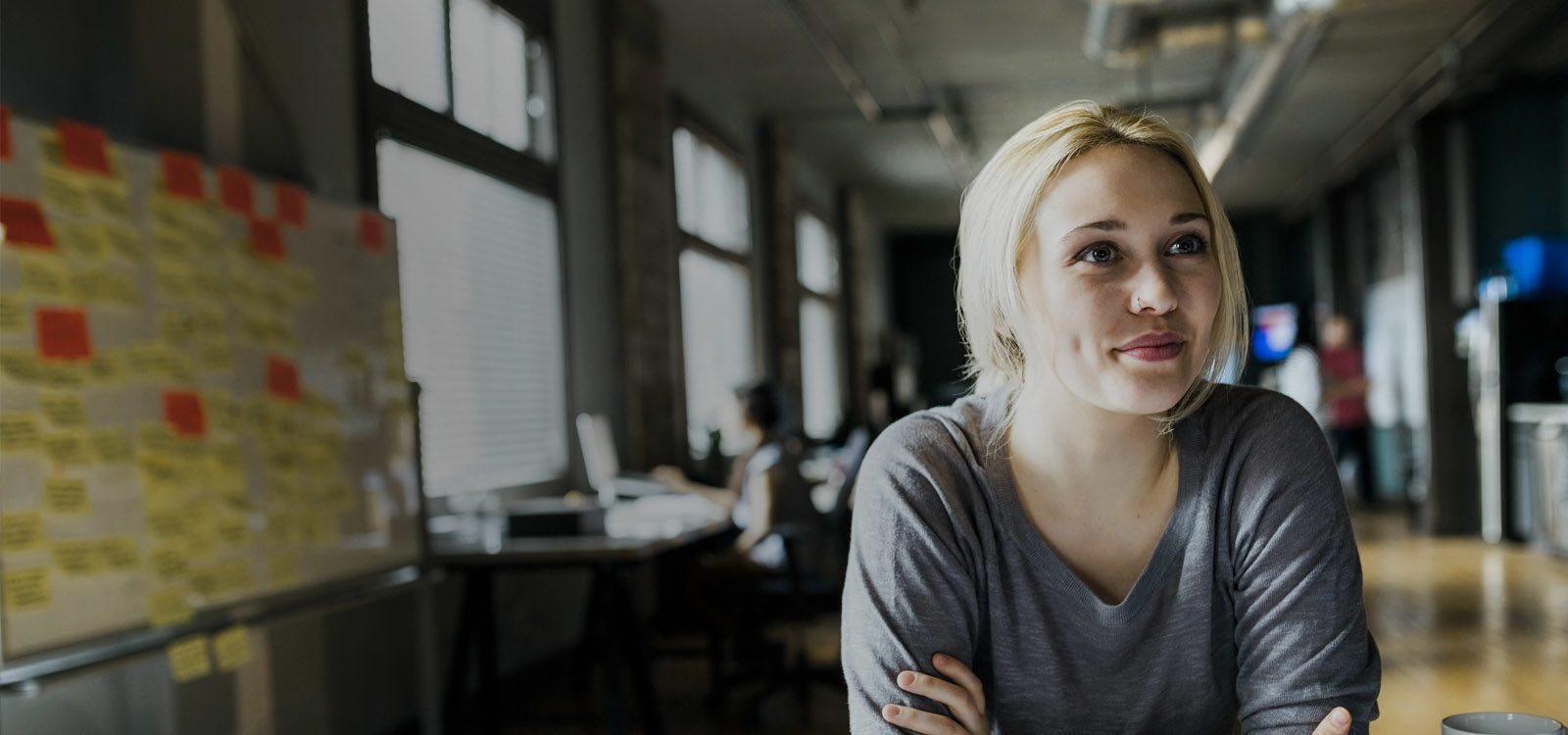 Creative businesswoman smiling at an office desk